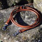 Guinzaglio tubolare da addestramento taglia L realizzato in cuoio nocciola con moschettoni in acciaio inox.